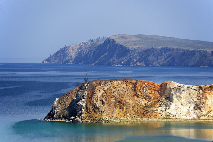 Scenic view of olkhon island against blue sky