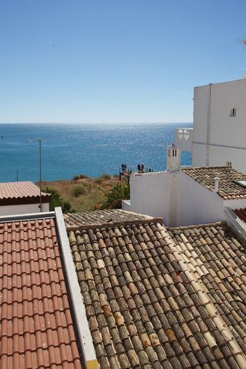Architecture Blue Charming Coast Coastal Town Day Fishing Vill Horizontal Mediterranean  Mediterranean Sea Modern No People Outdoors Pattern Portugal Roof Roof Tile Roofs Sky Solar Energy Solar Panel Tiles