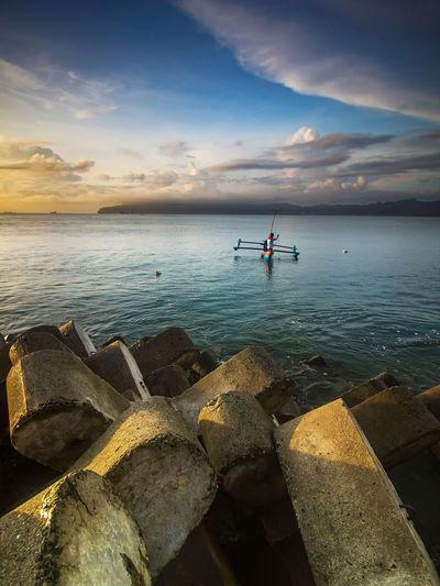 Man on boat fishing in sea