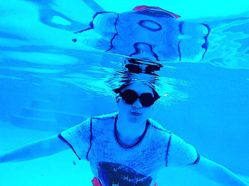 Gazisonit Underwater Submerged Reflection Goggles Swimming Pool Water Real People Blue Leisure Activity Front View One Person Lifestyles Swimming Day Young Adult Outdoors Portrait People