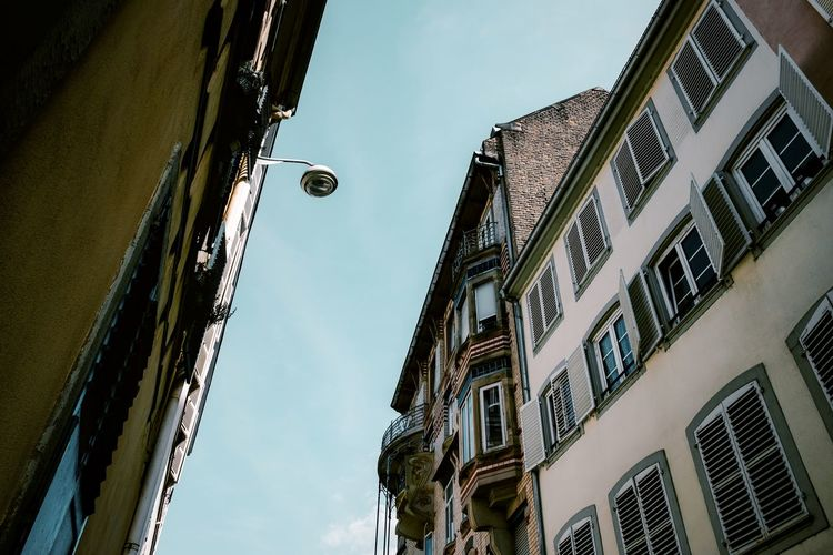 Urban Perspectives Street Photography The Devil's In The Detail Street Light Building Exterior Architecture Built Structure Low Angle View Building Window Sky Lighting Equipment Residential District Day No People City Cloud - Sky Street Electric Lamp Hanging Apartment The Architect - 2019 EyeEm Awards The Street Photographer - 2019 EyeEm Awards My Best Photo