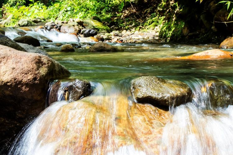 Mainit Hot spring Brook Beauty In Nature Blurred Motion Day Flowing Water Long Exposure Motion Nature No People Outdoors River Rock - Object Rocks Scenics Water Waterfall