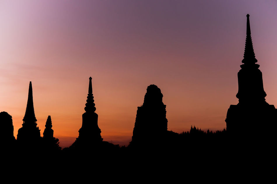 Historic sites are lined with stupas of different sizes. Pagoda Ruins Twilight Ancient Civilization Archaeological Architecture Beauty In Nature Building Exterior Built Structure Evening Historic Nature No People Outdoors Place Of Worship Religion Satupa Sculpture Silhouette Sky Spirituality Sunset Travel Destinations