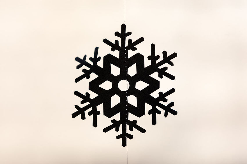 Silhouette of snowflake window decoration Celebration Christmas Hanging Shape Silhouette Tradition Backgrounds Christmas Decoration Christmas Ornament Close-up Cream Colored Day Decoration Glass - Material Indoors  No People Pattern Selective Focus Simplicity Single Object Snowflake Star Shape Symmetry Transparent Window