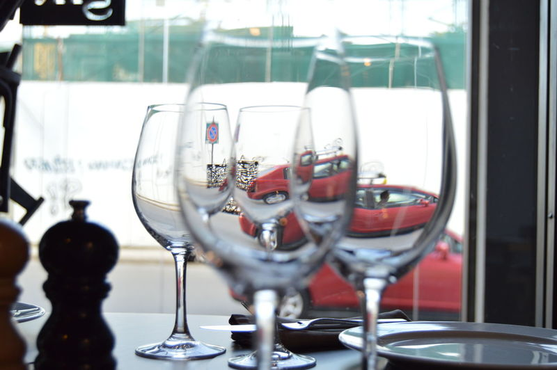 Close-up of wineglasses on table