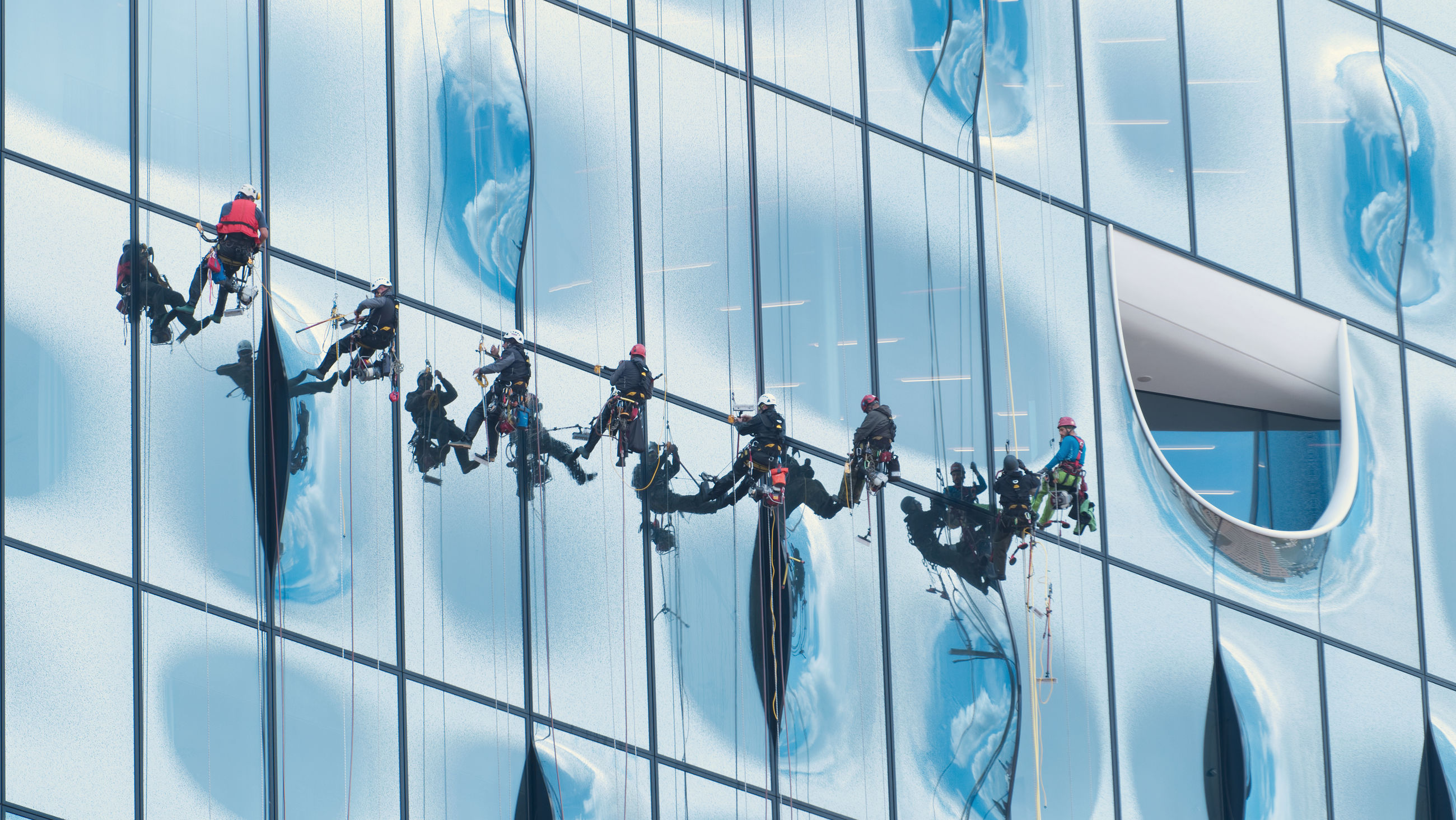 LOW ANGLE VIEW OF MODERN GLASS WINDOW