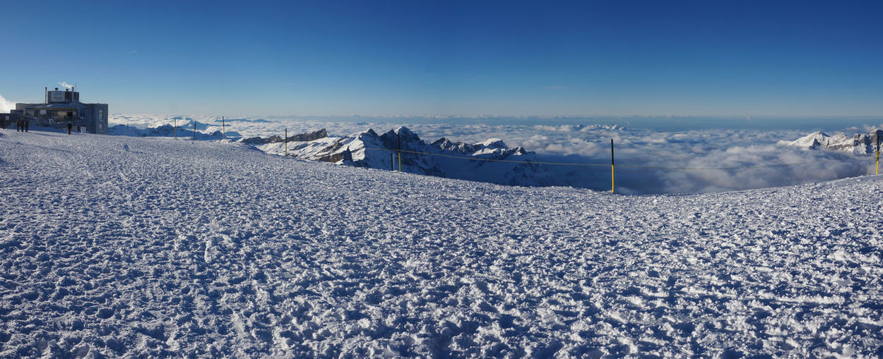 Panoramic shot of frozen landscape against blue sky