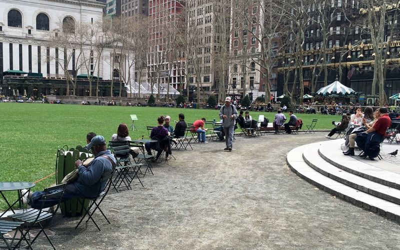 Architecture Building Exterior Built Structure City City Life Crowd Grass Group Of People High Angle View Large Group Of People Leisure Activity Lifestyles Men Mixed Age Range Person Sitting Street Walking Showcase April Bryant Park NYC Urban Geometry