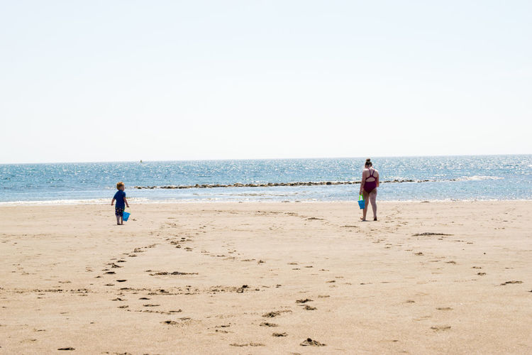 Wide angle of two children on beach