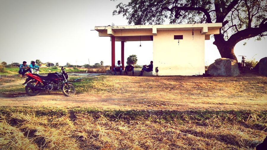 place to meet friends village memories Villagestory Temple Friends Waiting Relaxing Village Life Natural Farmfield Moring Sunlight Men Sky Architecture Built Structure Motorbike