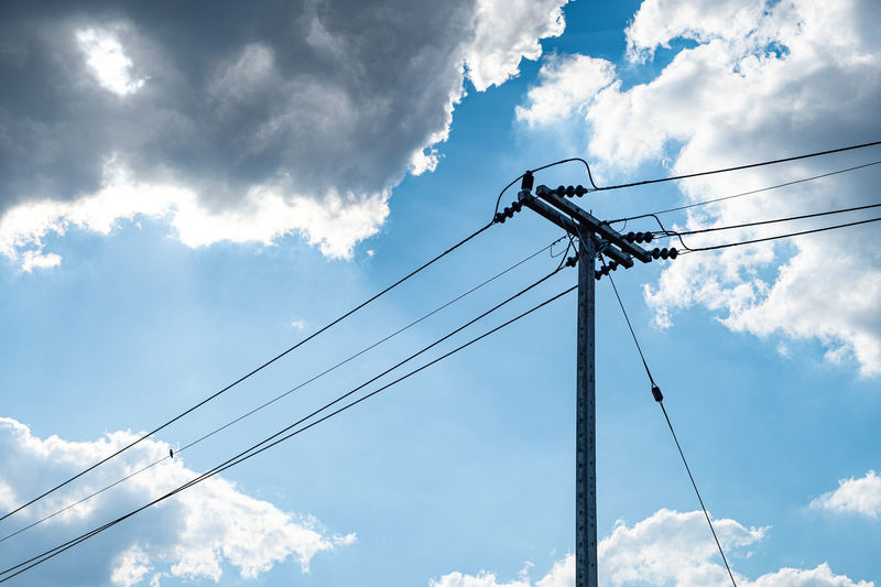 Electricity concrete post and high voltage wire at blue sky background