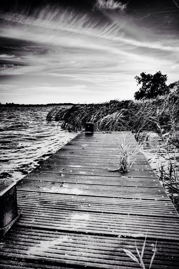 boat steeg - blackandwhite Blackandwhite Schwarzweiß Relaxing Time Calm Down Black And White Bootsanleger Urlaub ❤ Vacations Fine Art Fine Art Photography EyeEm Nature Lover Eyeemphoto Water Waterfront Sky And Clouds Dramatic Sky High Contrast