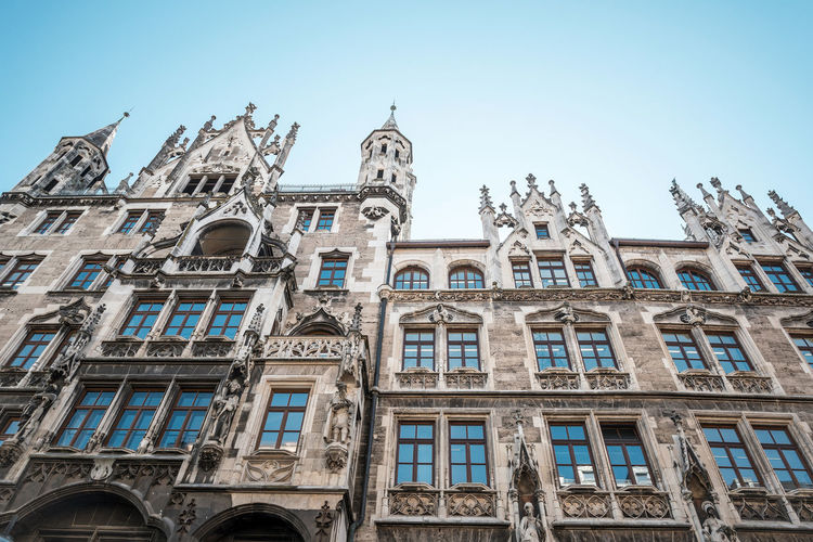 Arch Architecture Blue Building Exterior Built Structure Day Façade High Section Historic Landmark Low Angle View Marienplatz No People Ornate Outdoors Sky Travel Destinations