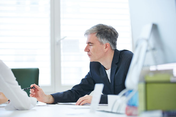 Side View Of Businessman Working In Office