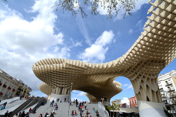 In Seville, in piazza della Encarnacion, you will find this cloud called Metropol Parasol. Sculptural wooden structure with an archaeological museum, a panoramic walkway and a lookout point. Setas De Sevilla Andalusia Encarnacion Seville Encarnación Square Metropol Parasol Sevilla Seville Architecture Building Building Exterior Built Structure City Cloud - Sky Crowd Day Group Of People Incidental People Large Group Of People Low Angle View Nature Outdoors Real People Tourism Travel Travel Destinations