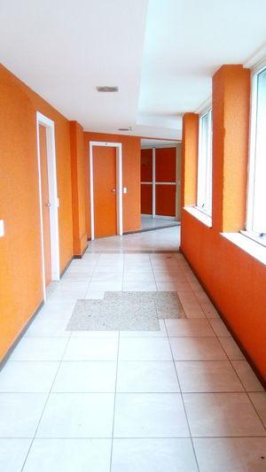 Corredor EyeEm Selects Modern Corridor Orange Color Architecture Built Structure Architectural Design Architectural Detail Entrance Entry Geometric Shape Closed Door Hallway Entryway Tiled Floor Open Door Archway Closed Architectural Feature Front Door Door Ceiling Entrance Hall Tile