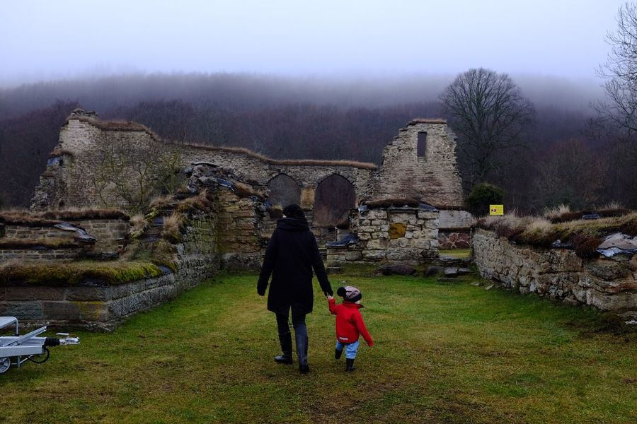 Walking In The Ruins Architecture Real People History Walking Two People Built Structure Rear View Sweden Travel Destinations Ancient Building Exterior Outdoors Beauty In Nature Day