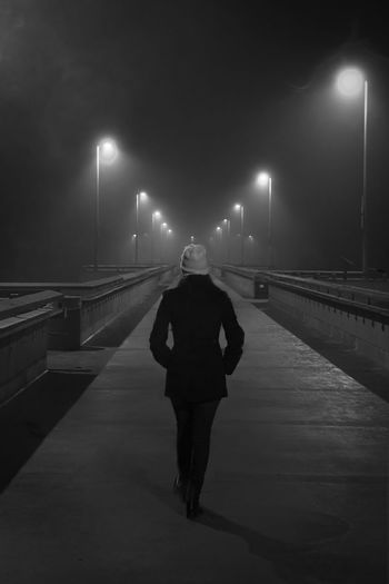 Night Black And White Bridge Fog Rear View Girl Foggy Illuminated Street Light Foggy Night One Point Perspective Dramatic Lifestyles White Hat The Way Forward Casual Clothing Leisure Activity Diminishing Perspective Bridge At Night Foggy Light Walking On Bridge Isolation Alone To The Future Onward