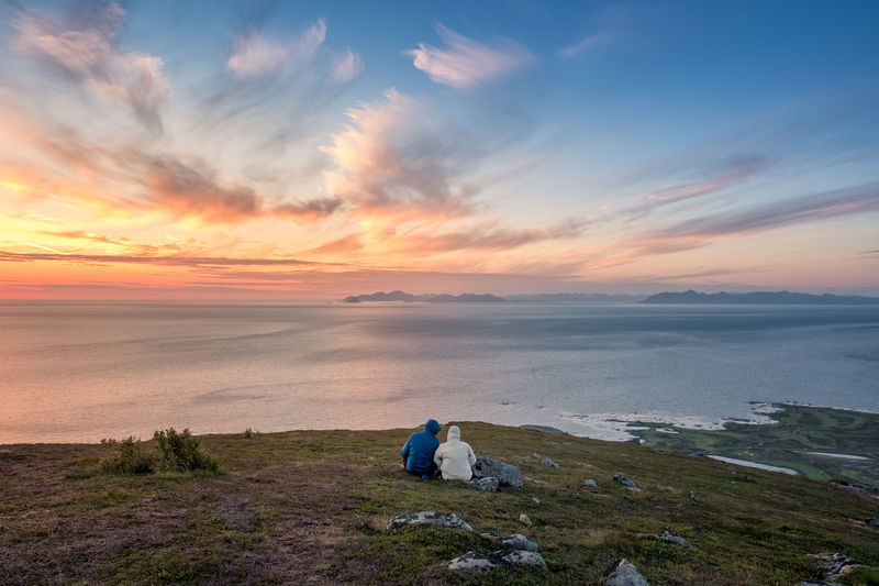 Couple enjoy sunset at summer night in top of the mountain Lofoten, Norway Couple Norway Romantic Beauty In Nature Cloud - Sky Dawn Enjoying Life Horizon Over Water Idyllic Landscape Lofoten Mountain Mountain Range Nature Orange Color Outdoors People Real People Scenics Sea Sky Sunset Togetherness Tranquil Scene Tranquility