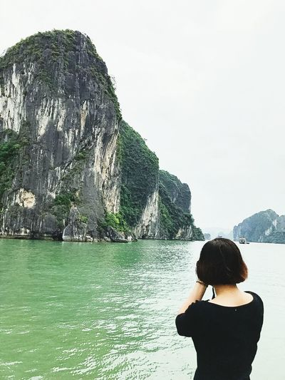 Water Rear View Standing Mountain Leisure Activity Lifestyles Scenics Person Beauty In Nature Lake Tranquil Scene Tranquility Long Hair Nature Sea Sky Vacations In Front Of Non-urban Scene Day