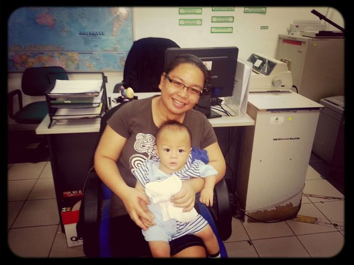 Wife and son visiting daddy's office.