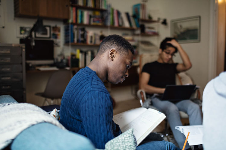 Men sitting on book