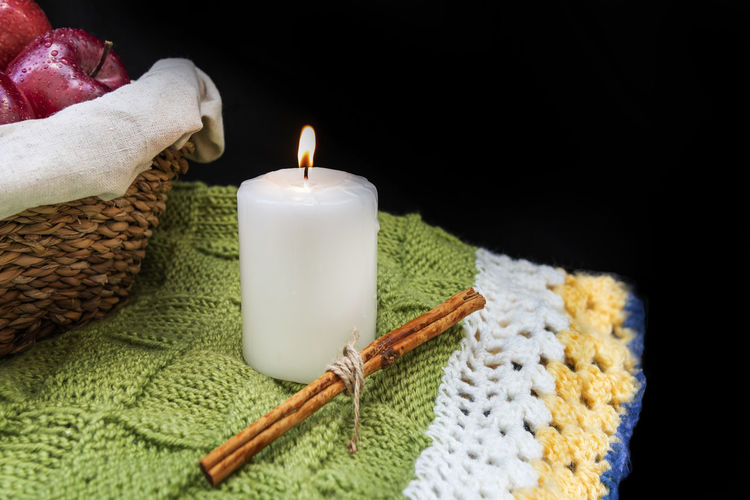 White candle and a stick cinnamon on rustic background with copy spac Indoors  Studio Shot Candle Burning Fire Flame No People Close-up Still Life Black Background Apple Red Organic Healthy Wicker Basket Cinnamon Copy Space Background Wallpaper Fresh Fruit Rustic Summer Diet Tasty Delicious Nutrition Agriculture Drops Water