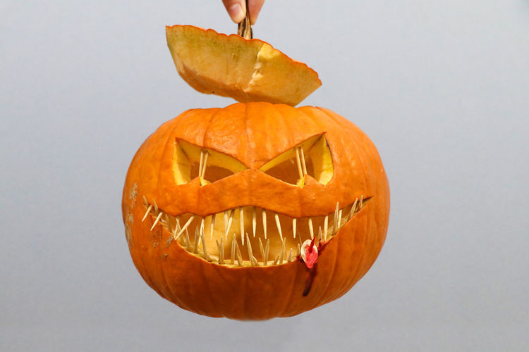 Food And Drink Food Pumpkin Halloween Jack O' Lantern Orange Color Face Anthropomorphic Anthropomorphic Face Studio Shot Celebration Indoors  Creativity Single Object White Background Vegetable One Person Close-up Carving - Craft Product Orange Halloween Pumpkin Seed Blood Scary