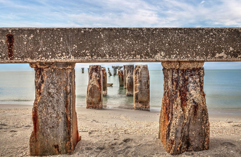 View of old built structure at beach against sea