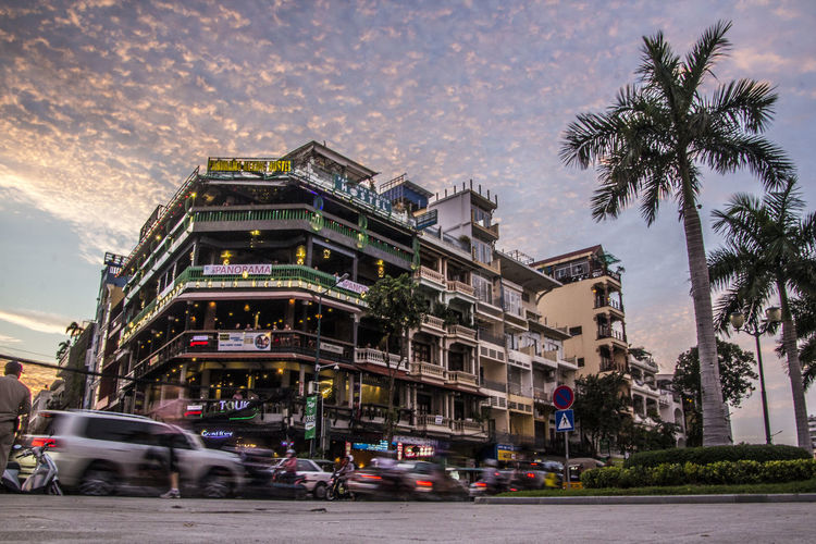 Cambodia Mekong River Architecture Building Building Exterior Built Structure Car City Cloud - Sky Land Vehicle Mode Of Transportation Motion Motor Vehicle Nature Outdoors Palm Tree Phnom Penh At Night Plant Road Sky Street Transportation Tree Tropical Climate