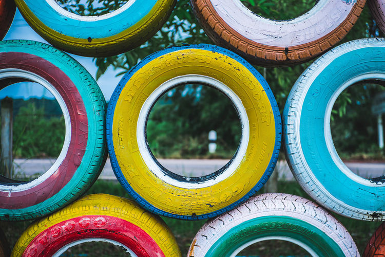 KNT Creative Playground Fun Playground Fun With The Kids Playground Structure Playground Equipment Backgrounds Blue Circle Close-up Day Full Frame Geometric Shape In A Row Metal Multi Colored No People Outdoors Pattern Playground Playgrounds Shape Stack Tire Wheel Yellow