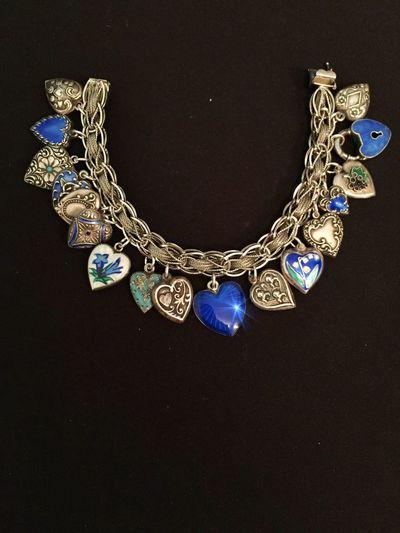 Antique and vintage charm bracelet. Blue. IPS2016Blue Blue Iphonephotography IPhoneography Iphone6 StillLifePhotography Nostalgia Antique Jewelry Vintage Handmade Bracelet Enamel Silver  Hearts Charms