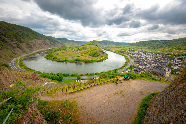 Mosel horse shoe bow and wine plants in Bremm, Rheinland-Pfalz, Germany, May 2019 Germany Mosel Moselschleife Bremmer Calmont Cloud - Sky Scenics - Nature Beauty In Nature Tranquil Scene Sky Environment Mountain Landscape Tranquility Nature Day Non-urban Scene No People Water Plant Road Outdoors Bremm River Architecture High Angle View Built Structure Green Color