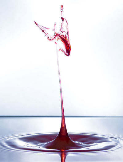 Close-up Day Drop Freshness High-speed Photography Indoors  Liquid Motion No People Red Studio Shot Water White Background