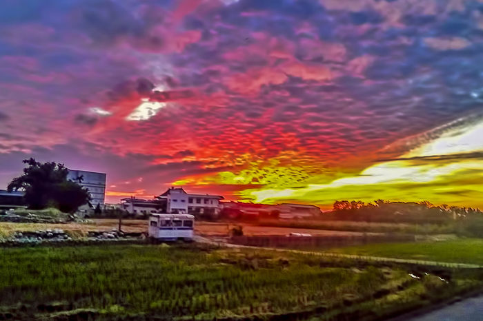 Agriculture Architecture Beauty In Nature Building Exterior Built Structure Cloud - Sky Dramatic Sky Farmhouse Field Grass House Landscape Nature Night No People Outdoors Residential Building Romantic Sky Rural Scene Scenics Sky Sunset