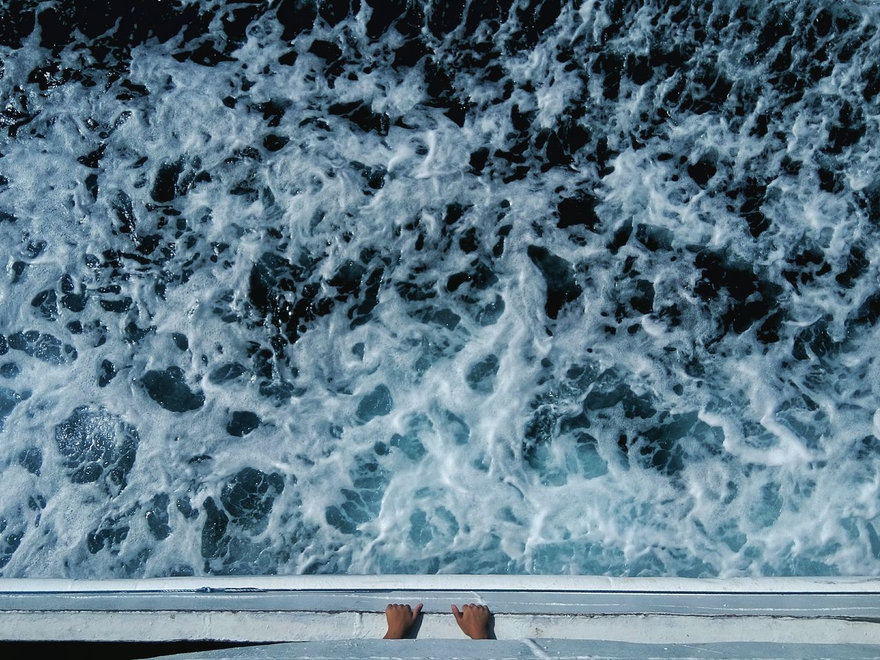 Directly above view of person in boat over sea
