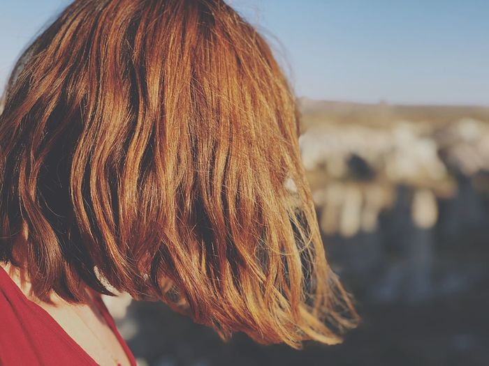 Close-up of redhead woman in city