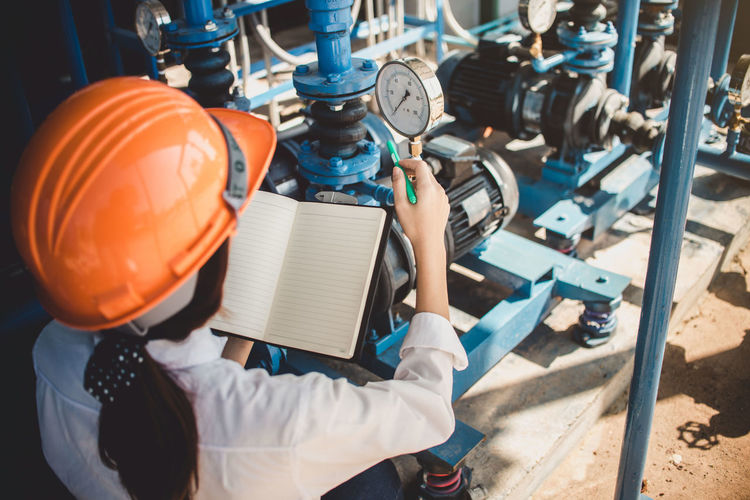 High angle view of boy working