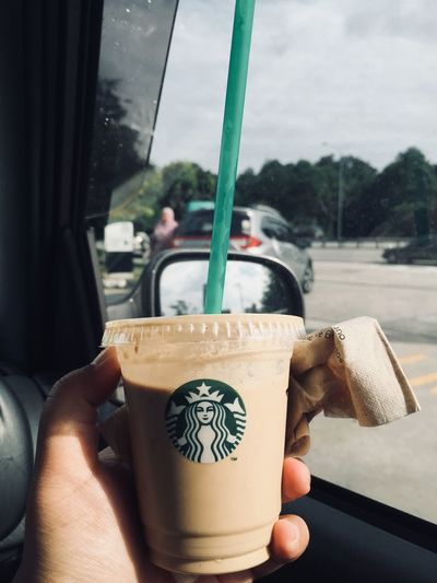 starbuck coffee with humans hand Real People Lifestyles Glass - Material Holding Leisure Activity Day Focus On Foreground Outdoors Drinking Human Hand Nature Refreshment Women Food And Drink Men Window Human Body Part Drink Transparent Hand