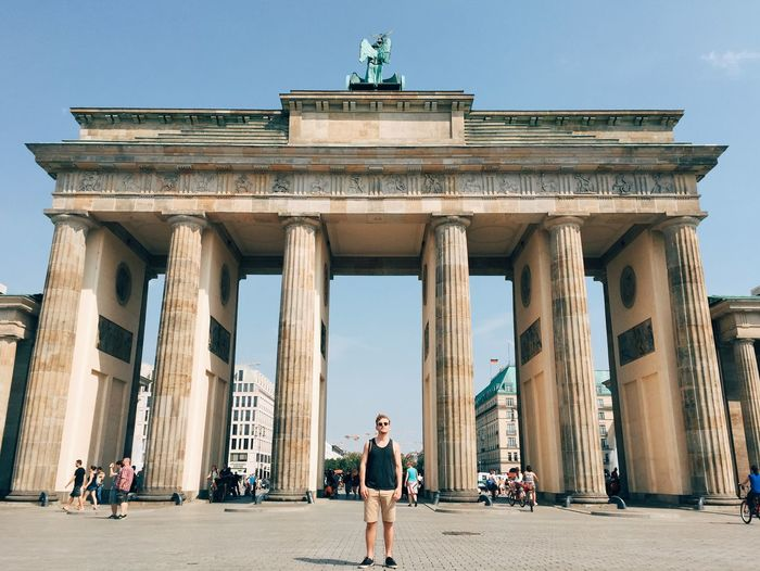 Man standing against brandenburg gate