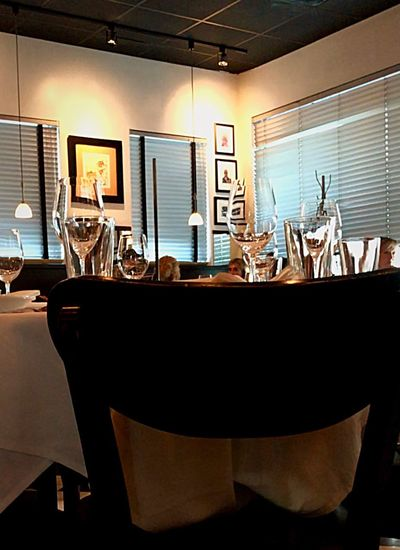 Quiet before dinner rush Muted Colors Venetian Blinds Pictures On Walls Art is Everywhere Crystal Wine Glasses No People Shadows And Light Down Light China Plates Candles Shhhhhh  Linen Napkin Indoors  Business Table Office Corporate Business No People Projection Screen Absence Seat Mirror Chair Restaurant