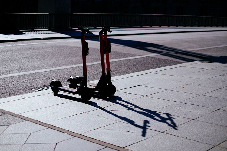 Push scooters on footpath in city
