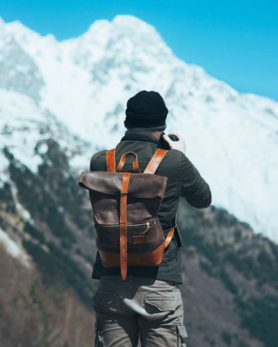 In the wild Backpack EyeEm Selects Winter Clothing One Person Snow Cold Temperature Mountain Standing Rear View Nature Hat Leisure Activity Real People Men Day Lifestyles Unrecognizable Person Outdoors