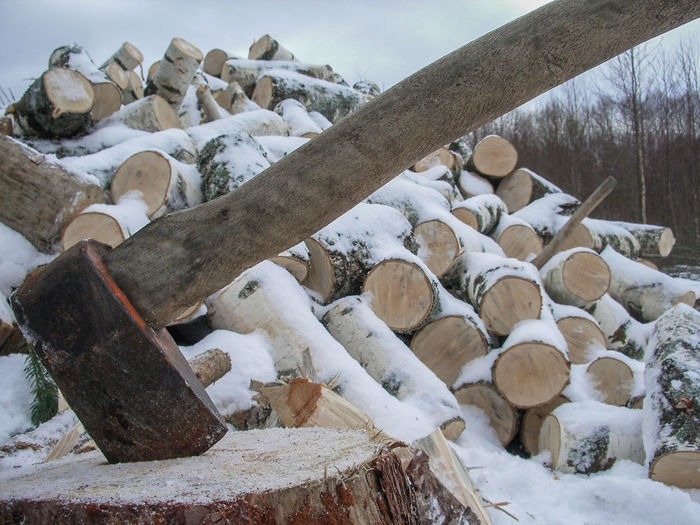 Time to chop wood Axe Day Large Group Of Objects Log No People Outdoors Sky Snow Stack Wooden