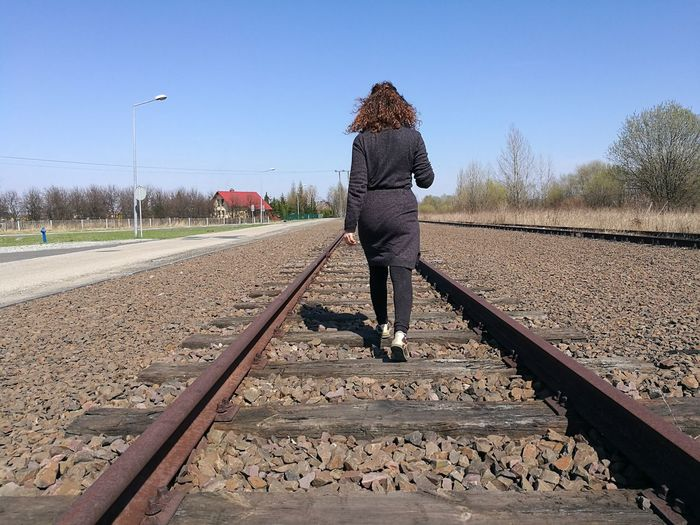 Adult Adults Only Clear Sky Day Full Length One Man Only One Person Only Men Outdoors People Rail Transportation Railroad Track Sky Transportation Tree