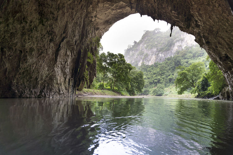 Beautiful natural scenery of Phong cave with boat tour at Ba Be Lake Nation Park is a famous travel destination in Bac Kan province, Vietnam. Ba Bé Lake Bac Kan Magical Tourist Transportation Travel Beauty In Nature Boats Cave Environment Foggy Forest Jungle Mountain Nature Outdoors Peaceful Reflection River Rock Scenics - Nature Tourism Tranquil Scene Tranquility Vacation