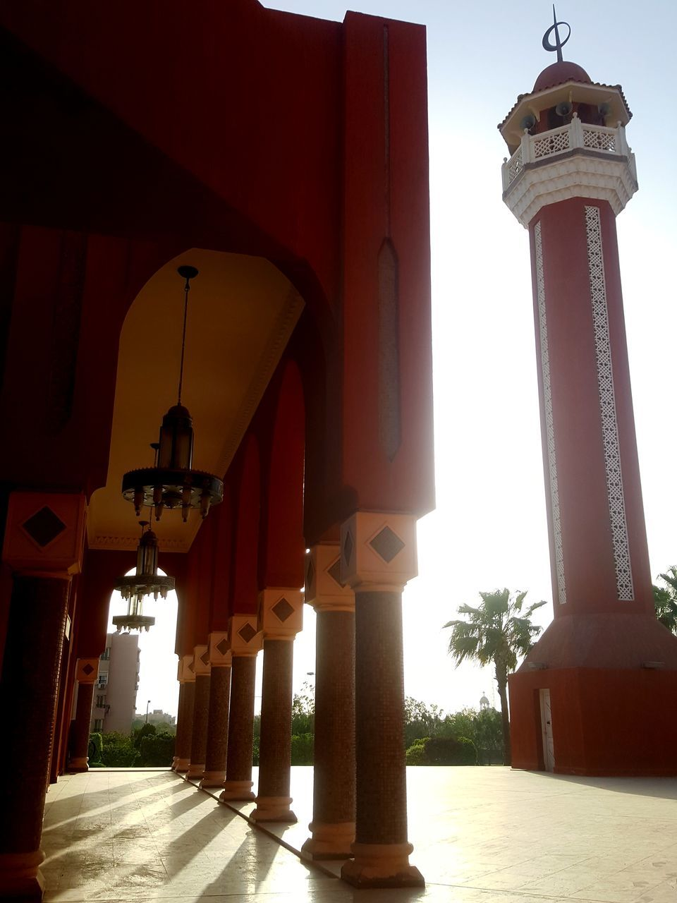 architectural column, architecture, built structure, red, pillar, building exterior, day, outdoors, lantern, no people, illuminated, sky