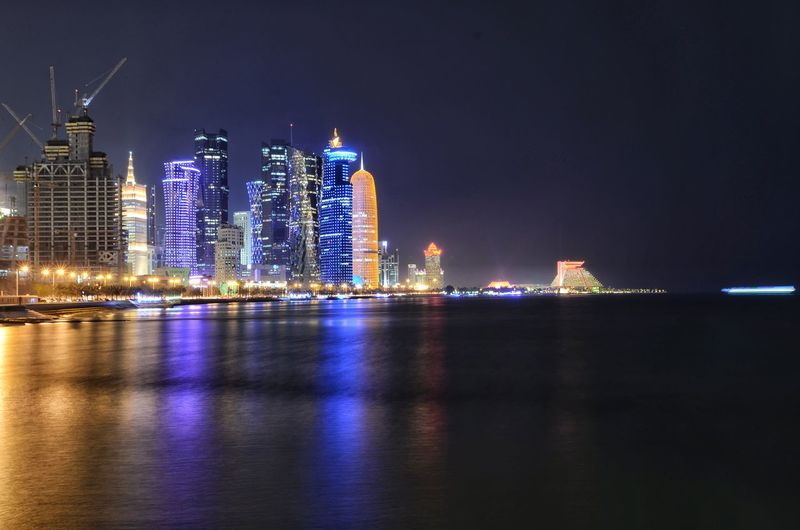 illuminated cityscape of doha qatar. Qatar Doha Architecture Landscape Landmark Gulf Middle East EyeEm Selects High City Cityscape Urban Skyline Illuminated Modern Skyscraper Business Downtown District Business Finance And Industry Nightlife Office Building Financial District  Tower Skyline Cctv Headquarters Tall Communications Tower Tall - High Tourist Attraction  Arch Bridge Light Trail