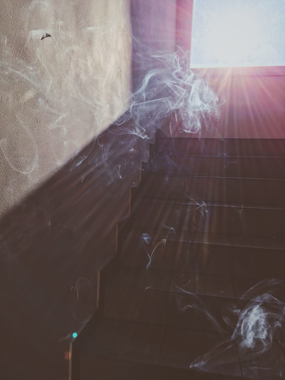 smoke - physical structure, indoors, no people, sunlight, close-up, sunbeam, day, window, nature, communication, lens flare, architecture, built structure, plastic, abstract, curtain, technology, emitting, motion, building