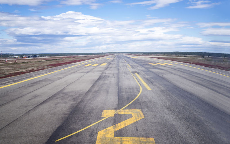 High angle view of airport runway against sky